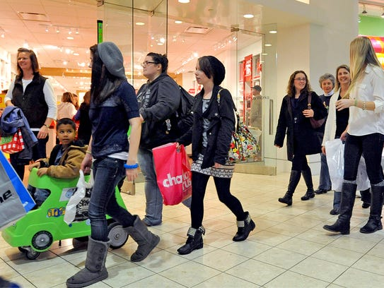 Shoppers walk through The Centre at Salisbury the day