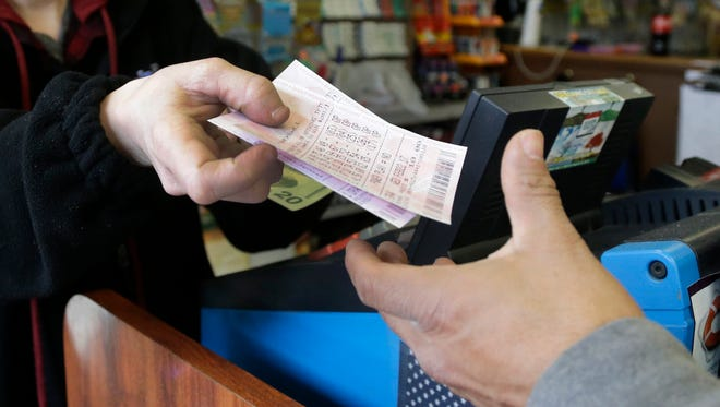 A Powerball ticket is sold to a customer.