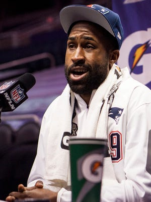 Brandon Browner of the New England Patriots answers questions at the Super Bowl media day held at the US Airways Center, Tuesday January 27, 2015 in Phoenix.