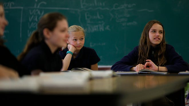 Students listen during Lourain Eggart's sixth-grade Spanish class at Our Lady of Lourdes school in De Pere.