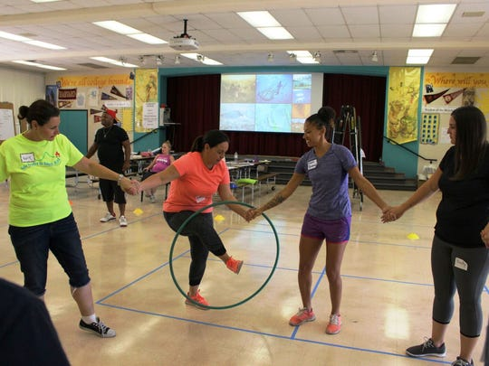 Physical exercise in school extends beyond the unorganized play of recess, as demonstrated during this summer training session for coaches and principals.