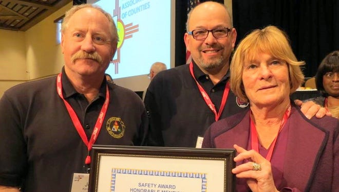 Lincoln County received a safety award from the New Mexico Association of Counties during a recent conference in Santa Fe. From left are County Emergency Services Director Joe Kenmore, County Commissioner Dallas Draper and County manager Nita Taylor.