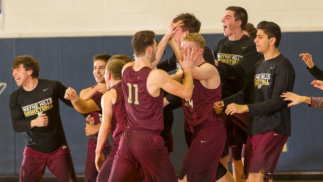 Wayne Hills celebrates after winning its first Passaic County boys basketball title.