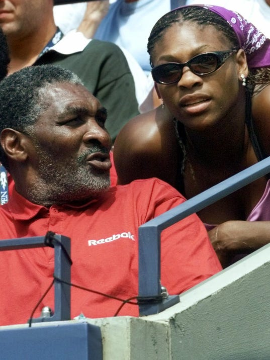 "FILE - In this Aug. 30, 2000, file photo, Richard Williams, the father and coach of United States' Venus Williams, of Palm Beach Gardens, Fla., speaks with daughter Serena during Venus' match against the Czech Republic's Kveta Hrdlickova at the U.S. Open tennis tournament in New York. His new book, ""Black and White: The Way I See It,"" comes out May 6. It goes into detail about how Indian Wells, as he writes, ""disgraced America."" (AP Photo/Suzanne Plunkett, File)"