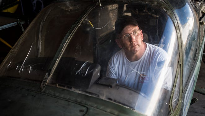 Mike Clary, a volunteer director of ground operations for the 2016 Airshow, sits in the cockpit of a 1969 retired U.S. Airforce O-2A plane he's working to restore at the Anderson Regional Airport on Tuesday, October 18, 2016.