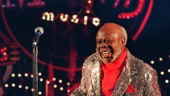 In silver-sequined jacket and shorts over red shirt, Rufus Thomas jump-starts the Memphis Rhythm and Blues Party in Nashville, Tenn. with his trademark Walking the Dog. The party was part of inaugural festivities in January 1995.