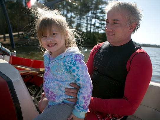 Bob Coley, right, hangs out with his granddaughter
