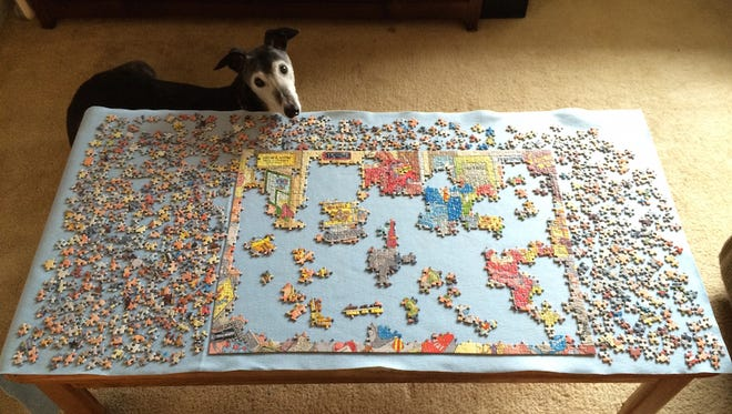 Working on a puzzle with all of the family.