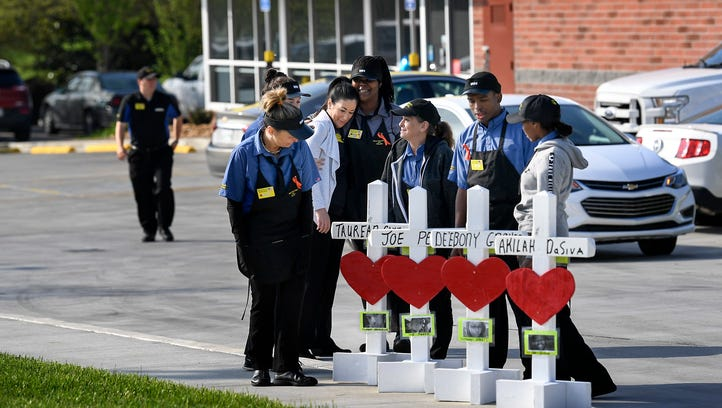 Before returning to work employees pay their respects