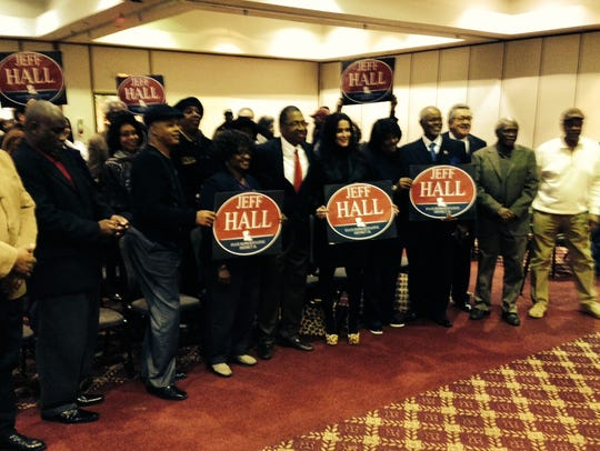 Supporters of Jeff Hall pose for a photo Monday after