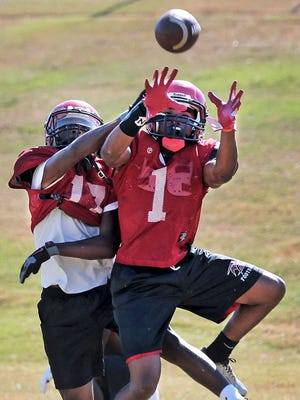 September 20, 2016 - Raleigh-Egypt's Caleb Gates (right) juggles a pass while running plays to prepare for Friday night's game. Three years ago the Pharaohs had to forfeit their final game of the year due to injuries and defections. Now they are 6-0 and about to play their biggest game. (Jim Weber/The Commercial Appeal)