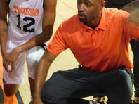 Lorenso Williams is shown talking to his team on the sideline recently. Williams is Opelousas High's third basketball coach in four seasons.
