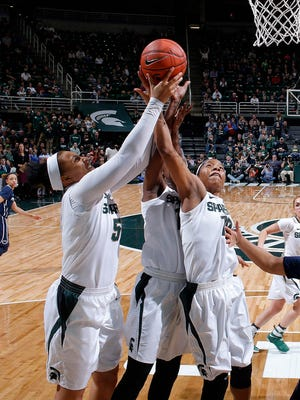 Michigan State's Kennedy Johnson, left, Victoria Gaines, center, and Branndais Agee, right, team up for a rebound against Penn State Wednesday, Feb. 22, 2017, in East Lansing, Mich. Michigan State won 73-64.