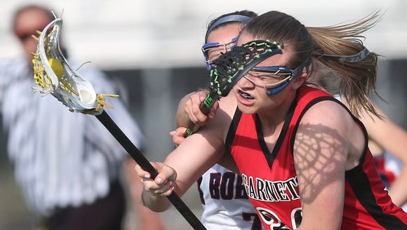 Rye defeated Byram Hills 13-12 in girls lacrosse action