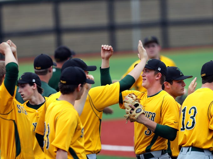 St. X's celebrates after defeating Trinity 6 to 2.  April 13, 2014