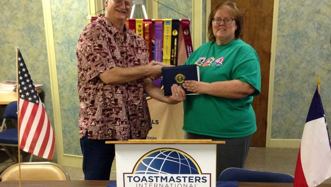 Wichita Falls Toastmaster Club No. 305 president Dave Rhue congratulates Denise Gough on receiving her Distinguished Toastmaster Award at a recent club meeting. The award was the culmination of several years of work in Toastmasters and represents the highest level of educational achievement in the organization. Less than 2 percent of the membership worldwide achieves this level of certification.