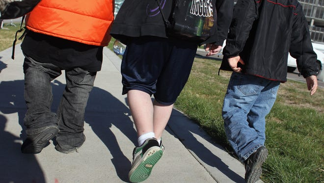 Children walk to an exercise class during the Shapedown program for overweight adolescents and children in 2010 in Aurora, Colo.