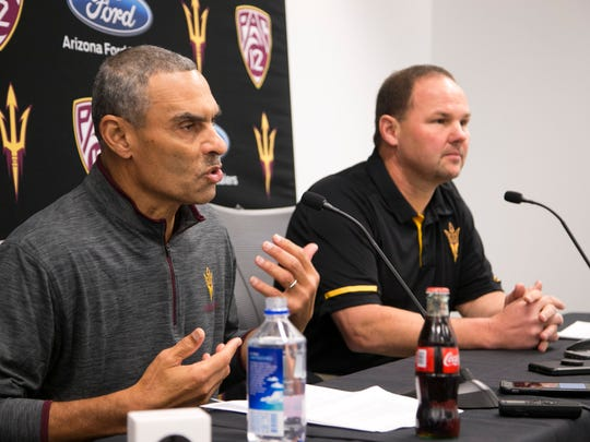 ASU head football coach Herm Edwards (left) talks about