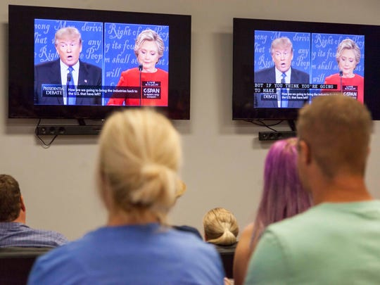 Students watch the first presidential debate at the Micheal O. Leavitt Center for Politics and Public Service at Southern Utah University on Monday, Sept. 26, 2016.