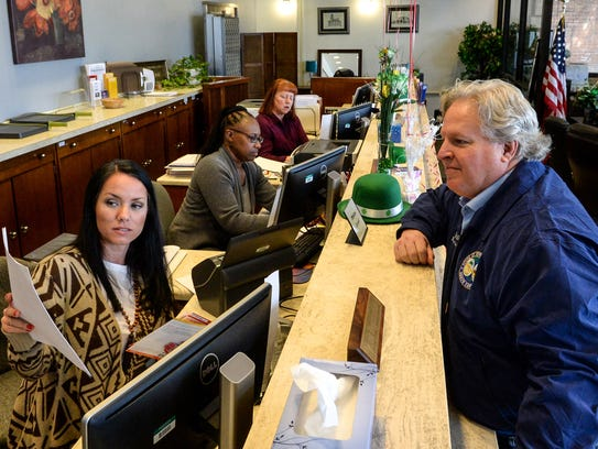 Laura Griffin, left, voter registration services supervisor, shows state Rep. Jay West paperwork to file for re-election at the Anderson County Registration and Elections office in Anderson on Friday.