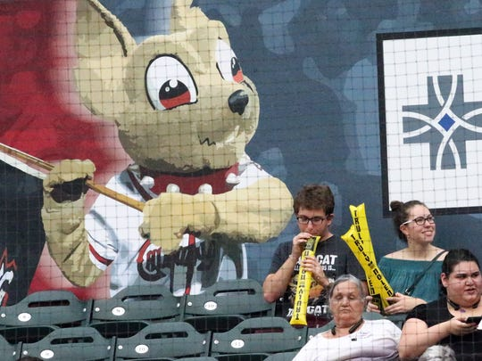 A fan blows up a freebie before the start of the game between the El Paso Chihuahuas and the New Orleans Baby Cakes at Southwest University Park.