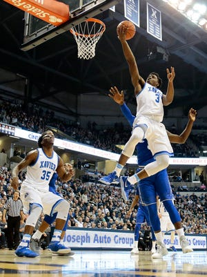 Xavier Musketeers guard Quentin Goodin (3) rolls in a layup.