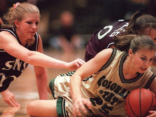 Becky Hammon, right, crashes to the floor and keeps the ball away from Southwest Missouri State's Kimberly McDowell, left, and Jackie Stiles in this historic game on March 14, 1999 at Moby Arena.
