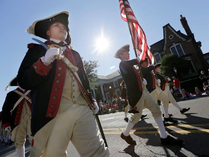 The Plymouth Fife and Drum Corps walks down Main Street