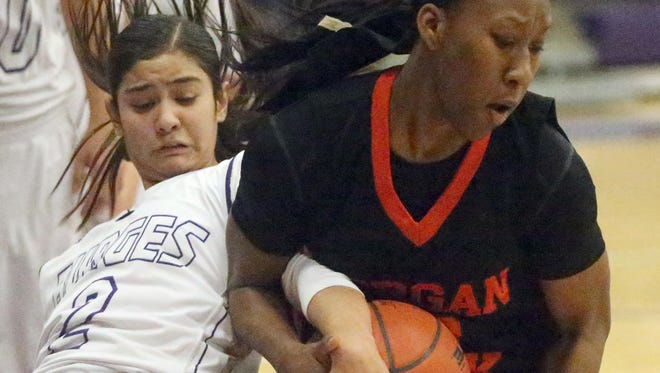 Becca Cardenas, left, of Burges gets her hand wrapped up with Cachet Johnson of Morgan Park on Thursday at Burges High.