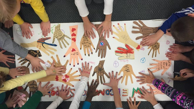 Students in Michele Hatchell's art class at Shorewood Elementary School in Madison, Wis., created artwork that embraces gender and cultural diversity as part of the Welcoming Schools project.