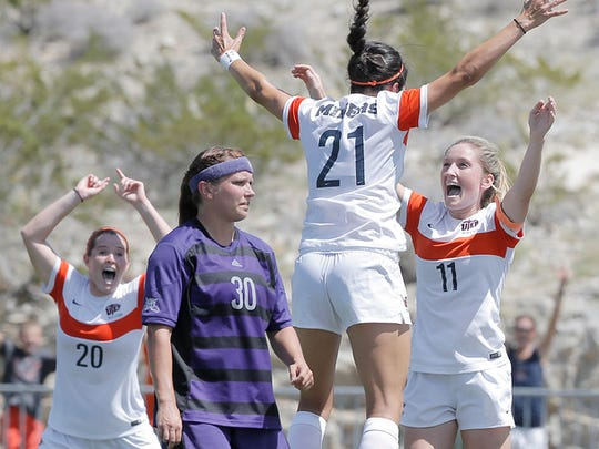 UTEP's Bri Barreiro (21) celebrates her goal with teammate Angela Cutaia (11) off a corner kick against Weber State. UTEP won the match 3-0.