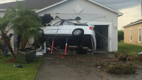An overturned minivan is seen after crashing into a house in Viera.