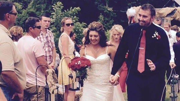 Zach and Kelsie Farmer walk down the aisle after their impromptu Sunday wedding.
