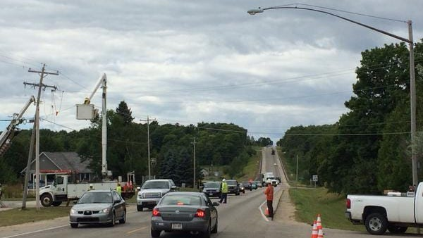 Utility contractors at work overhead slowed traffic on Wisconsin 42 coming into Sister Bay on Monday morning.