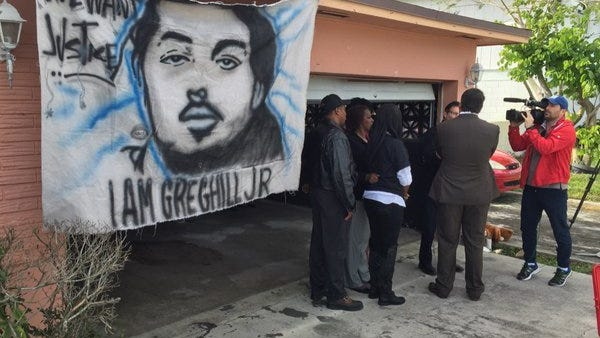 A banner depicting Gregory Hill Jr. is on display before a news conference with Hill's family at his home in Fort Pierce on Wednesday, January 20, 2016. Gregory Hill Jr. was killed in January 2014 after a confrontation with St. Lucie County deputies at his home in the 1500 block of Avenue Q in Fort Pierce. Hill's family announced Wednesday they are filing a lawsuit against the deputy and the St. Lucie County Sheriff's Office.