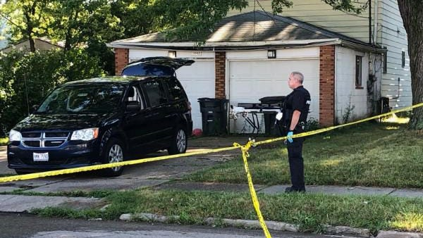 Akron police investigate a double homicide on Brown Street after a man and woman were found dead in a burning duplex early Tuesday in South Akron.