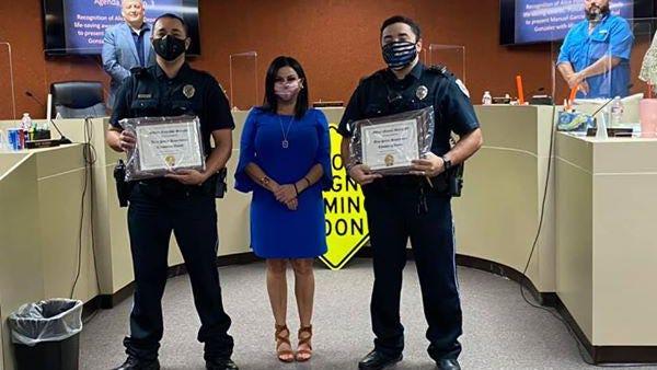 Alice Officer Cristobal Gonzalez and Officer Manuel Garcia received the Alice Police Department Life Saving Award with Mayor Jolene Vanover.