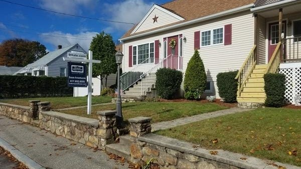 This home on Hale Avenue in Milford was for sale last year. The Massachusetts Association of Realtors said home sales were up last month when compared to May, but still down sharply from the same month a year ago.