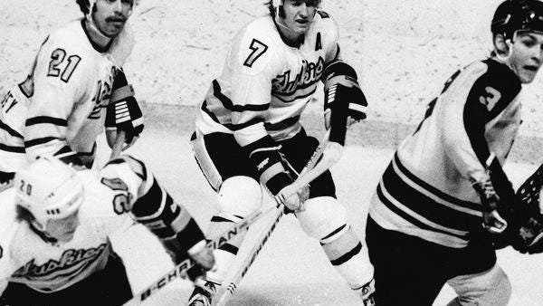 Mike Zuke (7) is pictured during his playing days at Michigan Tech. The Sault Ste. Marie, Ont. native was named to the WCHA 1970s All-Decade Team.