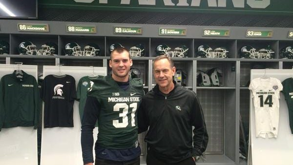 Drake Martinez, left, poses with Mark Dantonio in a photo from the defensive back's Twitter page. Martinez announced via the social media site Tuesday evening that he would become MSU's 16th football commitment for the 2015 season.