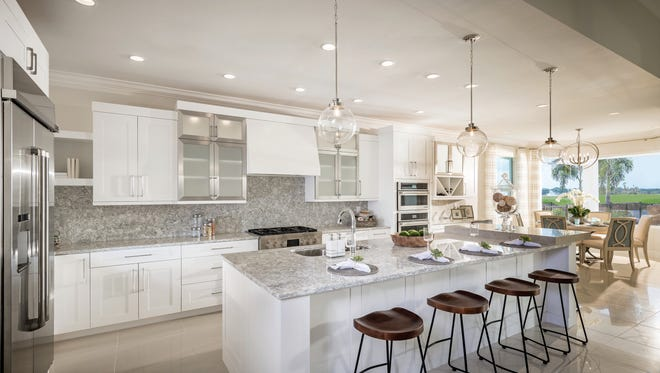 The Serino home design at Azure at Hacienda Lakes by Toll Brothers features an open floor plan, gourmet kitchen, and covered lanai.