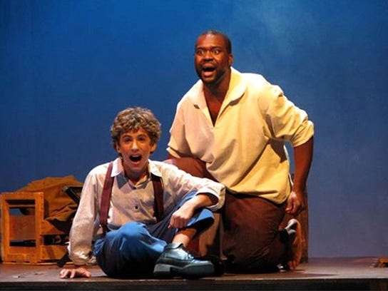 "Danny Kornfeld, left, plays Huck Finn in ""Big River"""