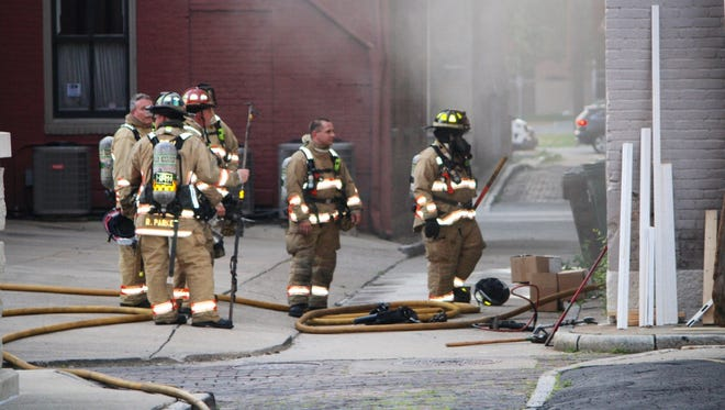 Fire crews knocked down the two alarm fire in the 800 block of Race Street Saturday night.