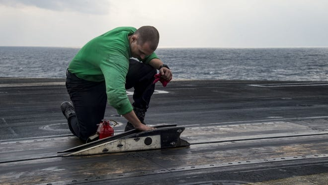 Seaman Dylan Haskell, from Genoa, at work on the USS Dwight D. Eisenhower.