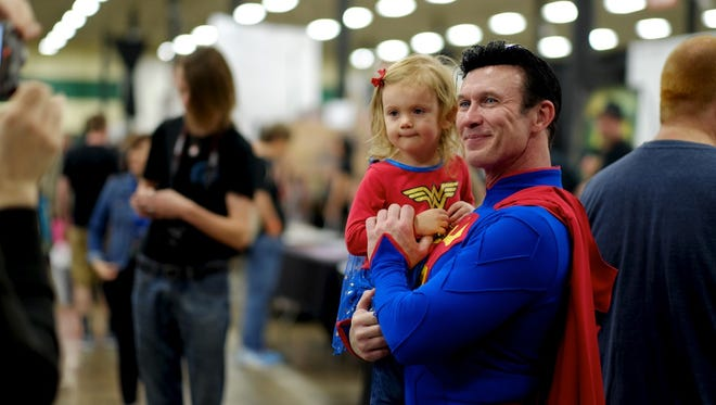 Natalie Tipton, 2, poses for pictures with Danny Kelley as Superman during the 2016 Marble City Comic Con at the Knoxville Expo Center on Saturday, April 23, 2016.
