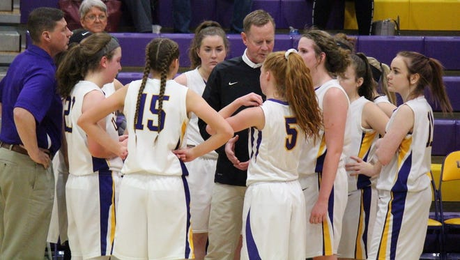 Unioto junior varsity coach Jimmy White takes a moment to talk with his team during a timeout in a game against Vinton County earlier this season.