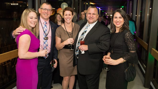 Attending Delaware Technical Community College's Mardi Gras Gala were, from left, Kim Morris, Delaware Tech Assistant Vice President for  Workforce Development and Community Education, Paul Morris; Delaware Tech Vice President and Campus Director, Dr. Bobbi Barends; Andrew Barends; and Delaware Tech Vice President for Academic Affairs, Justina Sapna.