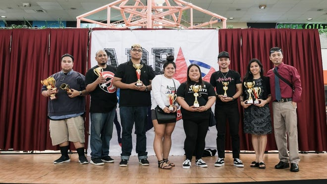 The Guam Allied Dance Force awarded the DOE dance team and Dance Club advisors at the Micronesia Mall last May for heading their respective schools in participating for this year's Guam DOE Allied Dance Force dance event. Benavente middle school received the Director's award for fundraising the most and Best Support System. Pictured from left: Francis Noel Labrador (JFK The Kennedy Originals), Ruel Estoy (Okkodo HYPE), Michael Natuel (BMS DanceVersity), Victoria Guiao (BMS DanceVersity), Camille Otchengco (BMS DanceVersity), Jun Jordan (BMS DanceVersity), Eiscelle Paulino (AMS The Fire Dragons), and C'zer Medina (ADF director).