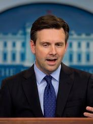 White House Press secretary Josh Earnest speaks to