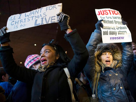 Protestors chant during a demonstration outside the